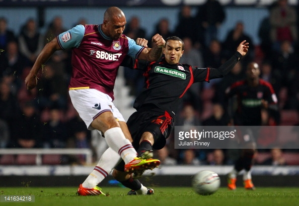 Seb Hines puts pressure on John Carew during Boro's last league meeting with West Ham | Photo: Getty