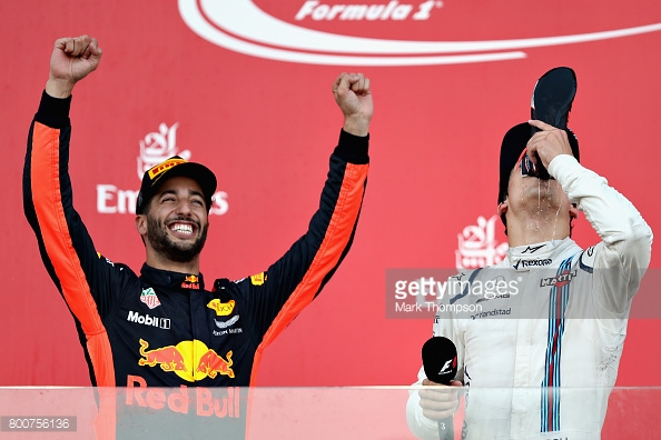 On his first podium visit, Stroll had the misfortune to share it with Ricciardo and his shoe. Bottas was absent from the shoey's. (Image Credit: Mark Thompson/Getty Images)