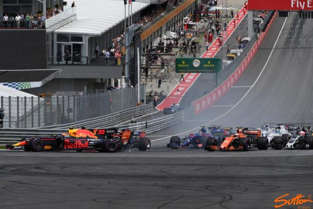 Verstappen, on the outside, is taken out by Alonso, who was taken out by Kvyat. (Image Credit: Sutton Images)