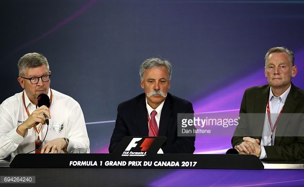 Chase Carey (C) and Sean Bratches (R) will experience their first British GP this weekend, while Ross Brawn (L) returns to Silverstone. (Image Credit; Dan Isitene/Getty Images)