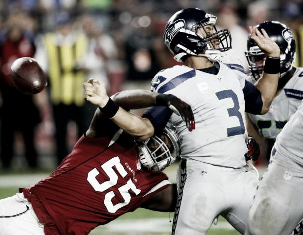 Chandler Jones forces Russell Wilson to fumble deep in Seattle's territory. |Source: AP / Ross D. Franklin|