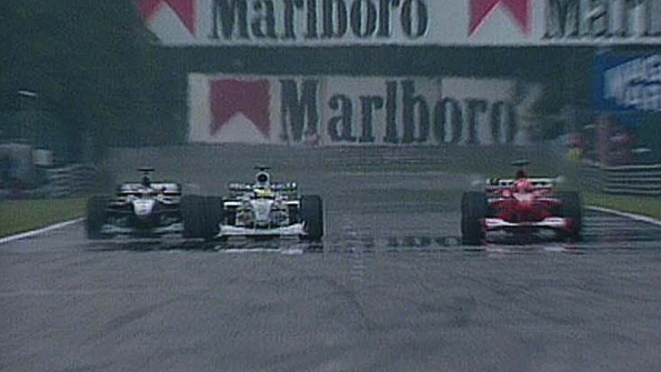 Hakkinen pulls off the greatest overtake in F1 history, symbolising the ferociousness of their rivalry (Image Credit: BBC)