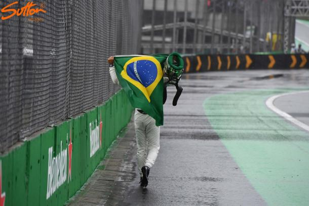 Drapped in his beloved flag, Felipe Massa bravely held back the tears in his final Brazilian Grand Prix. (Sutton Images)