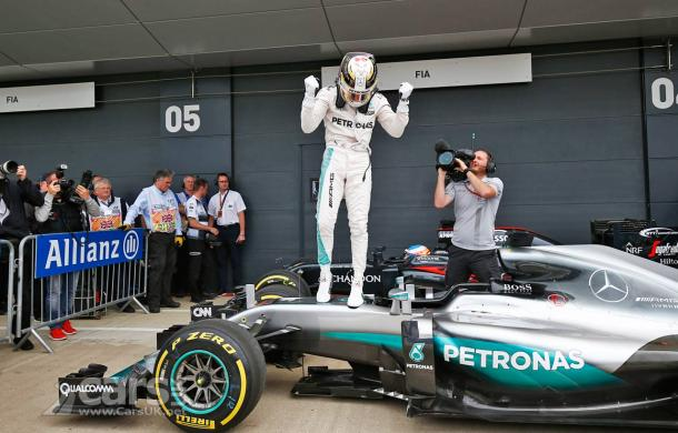 Lewis Hamilton celebrates his fourth British GP win, and third in a row. (Image Credit: www.carsuk.com)