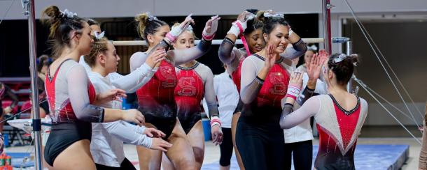 NC State celebrates a hit bar routine against Florida in Raleigh/NC State Athletics