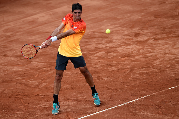 Thomaz Bellucci returning a shot in his match against Alexandr Dolgopolov at Rio Open (Photo:Buda Mendes/Getty Images)
