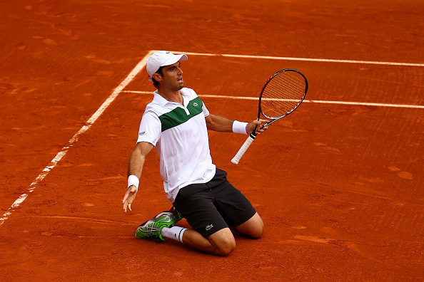 Pablo Andujar celebrating in his men's singles match after defeating Philip Kohlschreiber of Germany