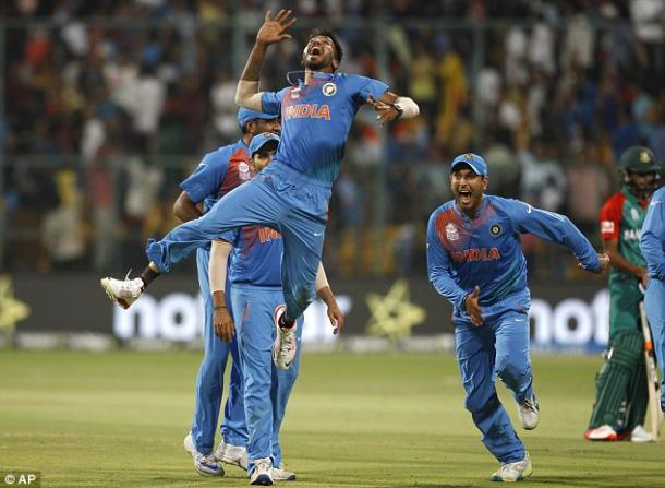 India celebrate their dramatic win against Bangladesh (photo: AP)