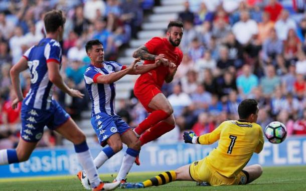 Ings puts the ball past Nicholls for Liverpool's first goal against Wigan (photo: Getty Images)