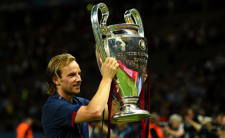 Rakitic holds the Champions League trophy aloft - after Barca's 3-1 victory over Juventus last year. | Photo: Getty
