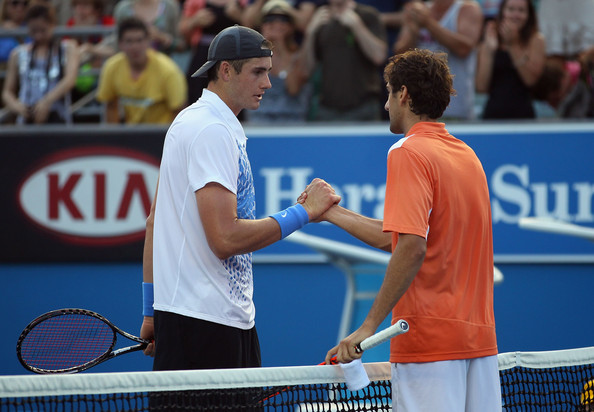Isner and Cilic shake hands at the net folowing the conclusion of their five set battle at the Australian Open in 2011 (Photo by Julian Finney / Getty Images)