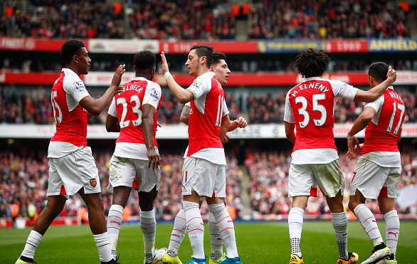 Alex Iwobi (far left) celebrates his well-taken finish to double Arsenal's comfortable lead | Photo: Getty