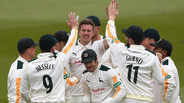 Ball celebrates with his teammates after taking the wicket of Root earlier this month | Photo: Getty Images