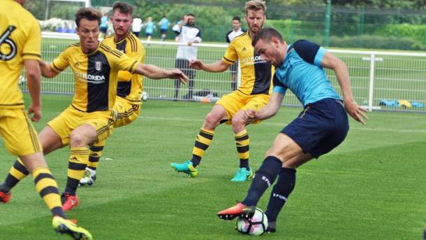 New-boy Vincent Janssen is closed down by Scott Parker (photo; Tottenham Hotspur)