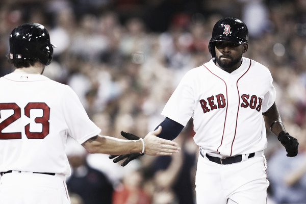 Blake Swihart (left) congratulates Jackie Bradley Jr. after scoring a run in the fifth inning. (Photo: Maddie Meyer/Getty Images North America)