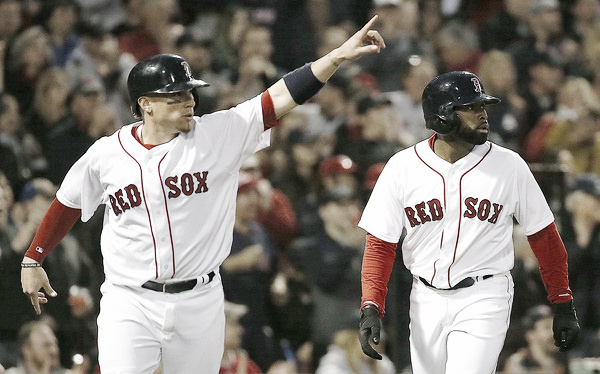 Christian Vazquez (left) and Jackie Bradley Jr. (right) react after Mookie Betts' double, scoring both runners. (Source: Jim Rogash/Getty Images North America)