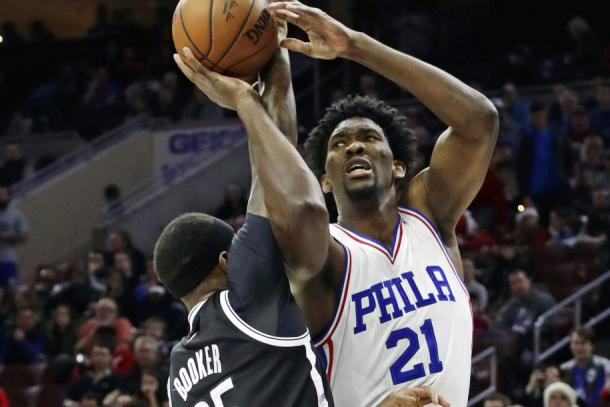 Joel Embiid shoots over forward Trevor Booker in last night's win. Photo: Associated Press