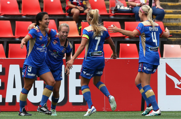 Jen Hoy (far left) celebrates with her teammates (Source: Ashley Feder/Getty Images AsiaPac)
