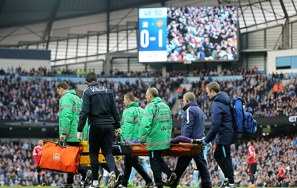 Hart was stretchered off early in the second-half, unable to put weight on his injured calf | Photo: Getty
