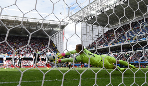 Hart struggles as his diving stop parries Bale's effort into the corner. | Photo: Getty