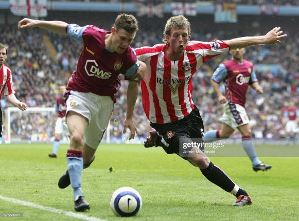 BIRMINGHAM, UNITED KINGDOM - MAY 07: James Milner of Villa holds off Danny Colins of Sunderland during the Barclays Premiership match between Aston Villa and Sunderland at Villa Park on May 7, 2006 in Birmingham, England. (Photo by Jamie McDonald/Getty Images)