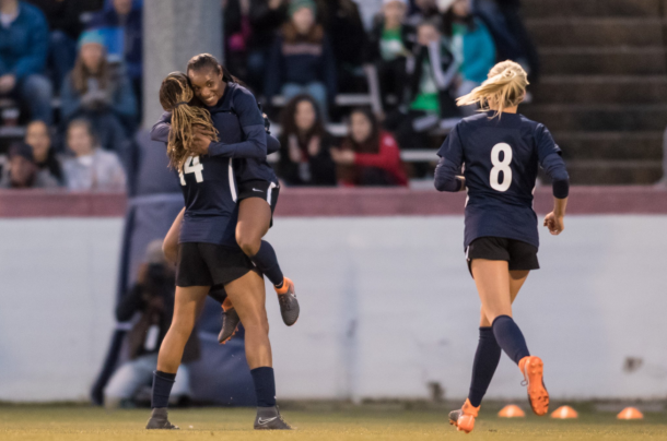 Forward Jess McDonald (14) celebrates with Crystal Dunn in their first match together during the 2018 preseason. | Photo: @J_Mac1422