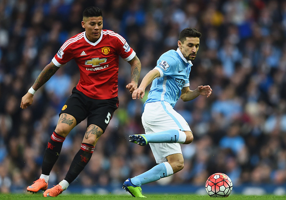 Navas attempts to skip past Rojo with the ball at his feet, in an encouraging display by the Spaniard | Photo: Getty
