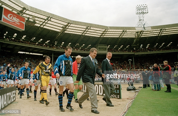 Joe Royle knows what it's like to be a successful Everton manager - as he is pictured leading his side out to what would be Everton's first cup win in four years | Photo: Getty images