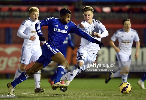 Joe Rodon battles for the ball with Chelsea's Kasey Palmer. | Photo: Darren Walsh/Chelsea FC via Getty Images