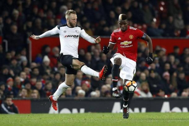 Johnny Russell taking on Paul Pogba | Source: The Associated Press