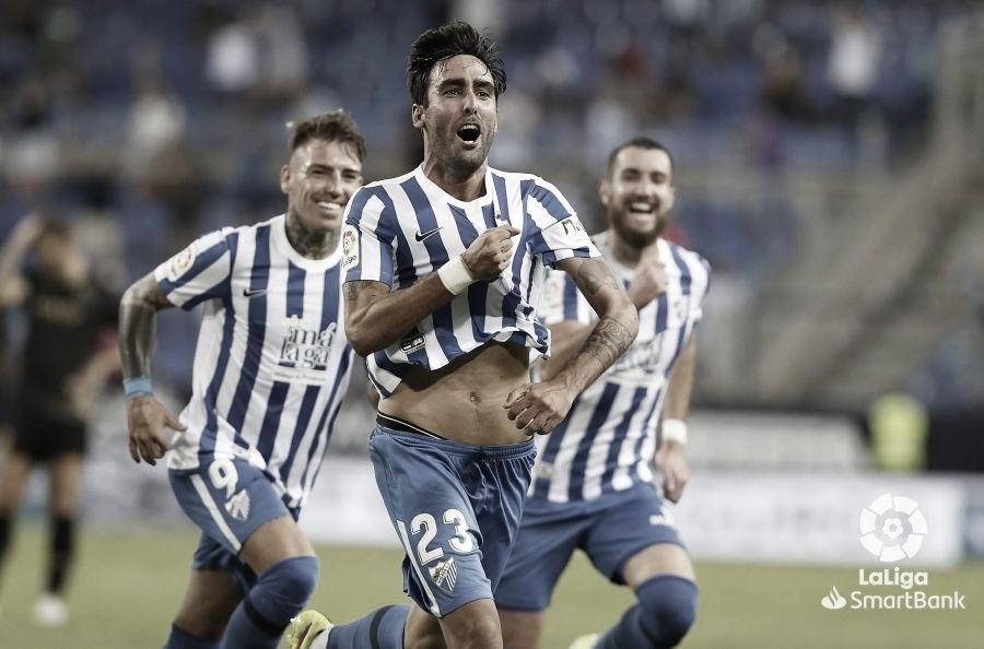A. Escassi celebrando el gol del triunfo del Málaga CF./ Foto: LaLiga.