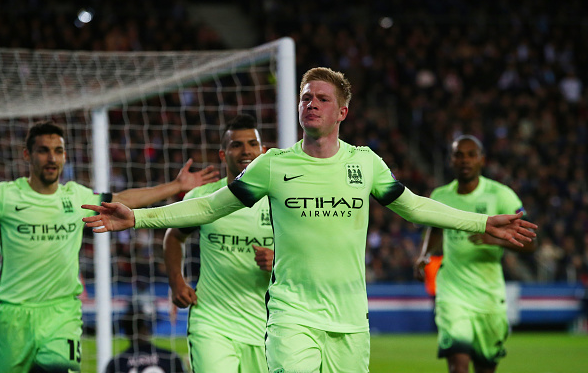 Kevin de Bruyne (centre) wheels away to celebrate breaking the deadlock in the first leg. | Photo: Getty