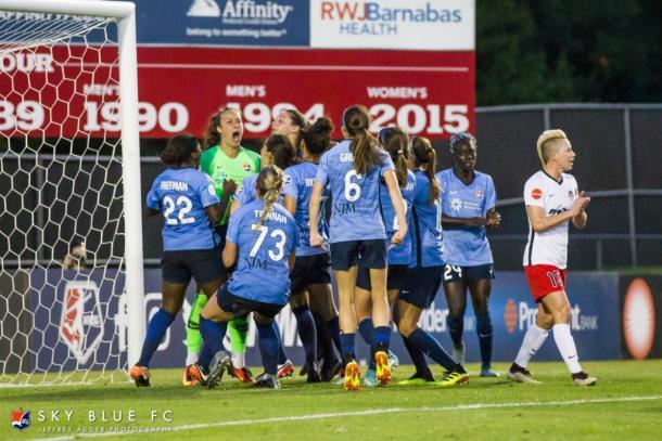 Sky Blue celebrating a Sheridan penalty kick save l Photo: Jeffrey Auger