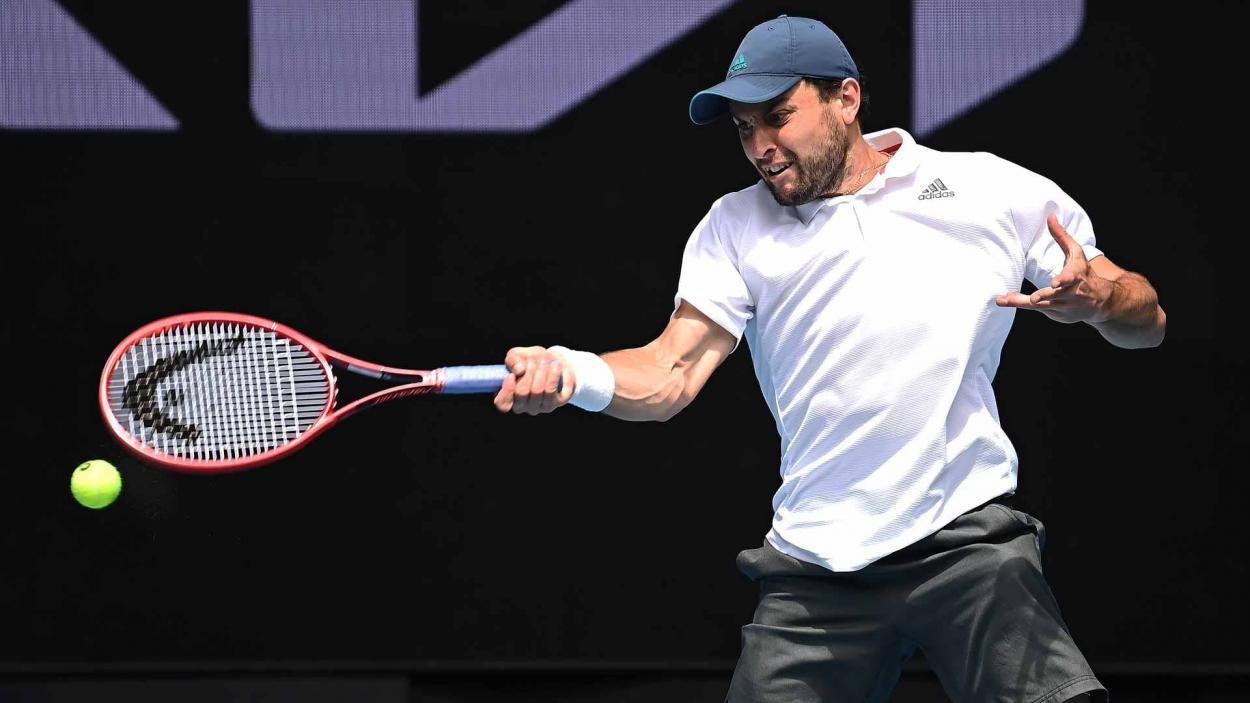 Karatsev plays a forehand in his fourth-round match/Photo: Peter Staples/ATP Tour