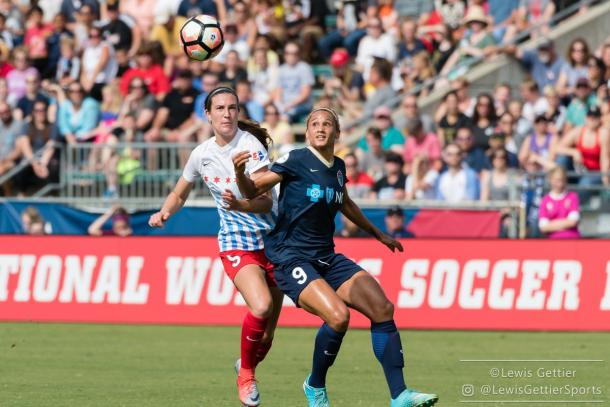 Katie Naughton (left) and Lynn Williams battle for the ball. Source: North Carolina Courage