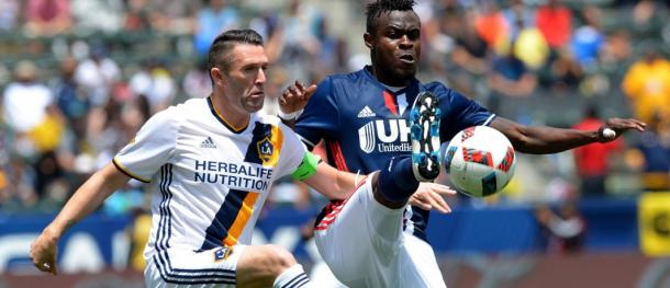 LA's Robbie Keane (Left) and New England's Gershon Koffie (Right) battling for the ball on Sunday at the StubHub Center. Photo provided by USA TODAY Sports.