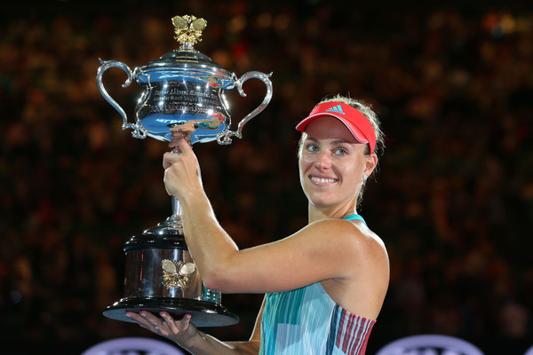 Kerber hoisting the Daphne Akhurst Trophy following a three set victory over Serena Williams (Photo by Michael Dodge / Getty Images)