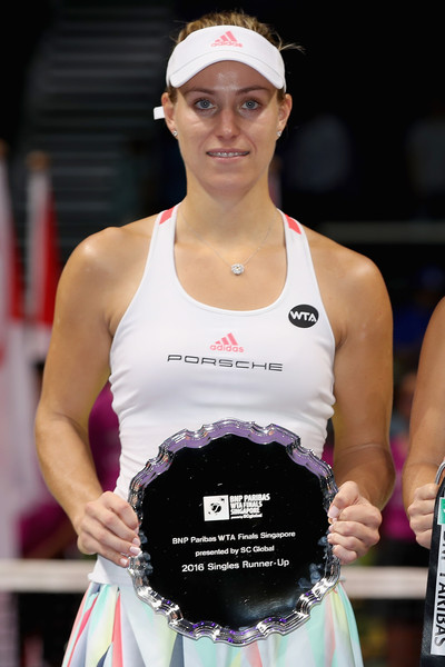 Kerber holding her runner-up trophy in Singapore (Photo by Matthew Stockman / Getty Images)