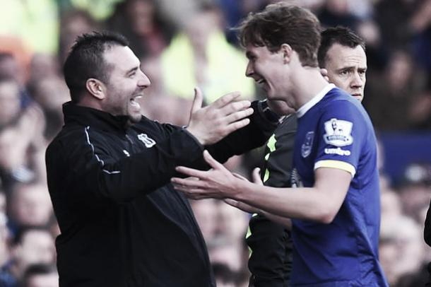 David Unsworth congratulates teenager Kieran Dowell after an impressive performance. | Photo: Getty Images