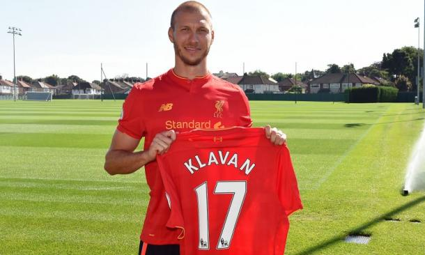 Klavan with the No.17 shirt he will wear for the club. (Picture: Liverpool FC via Getty Images)