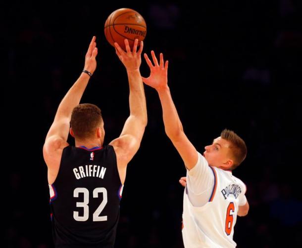 Los Angeles Clippers forward Blake Griffin (32) shoots over New York Knicks forward Kristaps Porzingis. Photo:Credit: Jim McIsaac/Newsday.