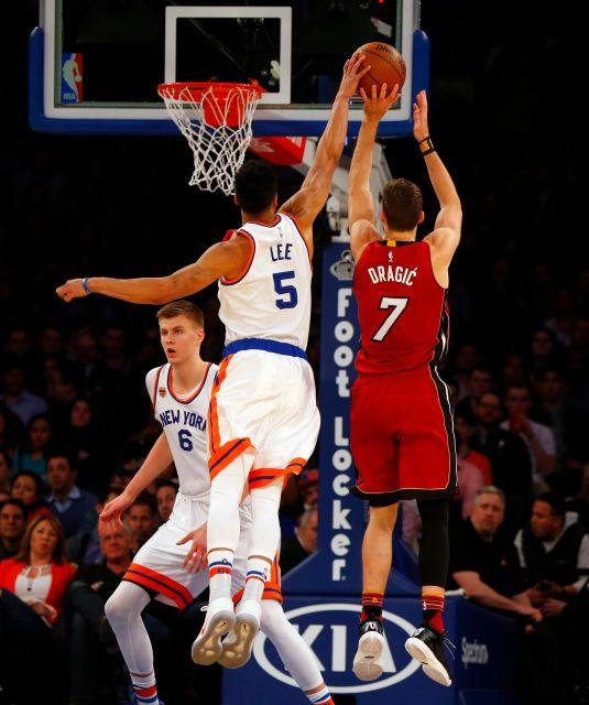 New York Knicks guard Courtney Lee(5) blocks Miami Heat  guard Goran Dragic (7). Photo by: Jim McIsaac/Newsday.