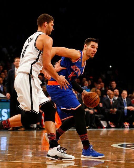 New York Knicks center Willy Hernangomez (14) holds the ball against Brooklyn Nets center Brook Lopez (11). Photo courtesy of Jim McIsaac, Newsday.
