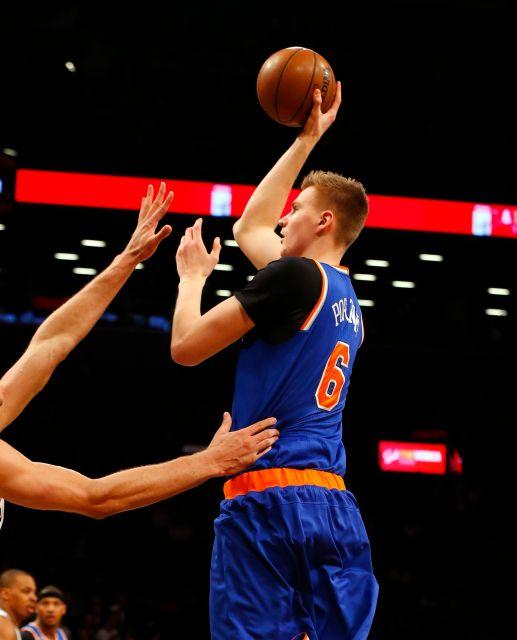 New York Knicks forward Kristaps Porzingis puts up a shot. Photo courtesy of  Jim McIsaac, Newsday.