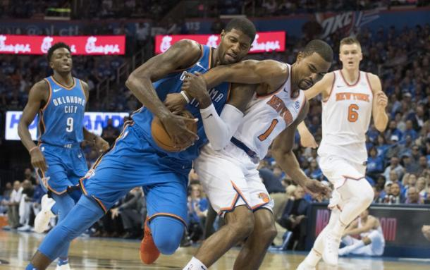 New York Knicks PG Ramon Sessions (1) attempts to steal the ball from Oklahoma City Thunder SF Paul George (13). Photo:AP/Sue Ogrocki
