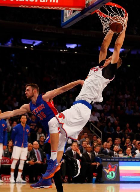 New York Knicks Foward Kristaps Porzingis dunks the ball and is fouled by Detroit Pistons foward Jon Leuer.