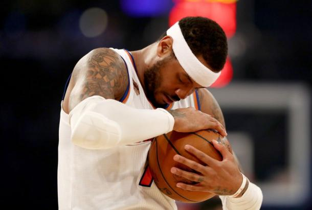 Carmelo Anthony doing his pre-game ritual before tip-off. Photo Courtesy: Getty Images / Elsa