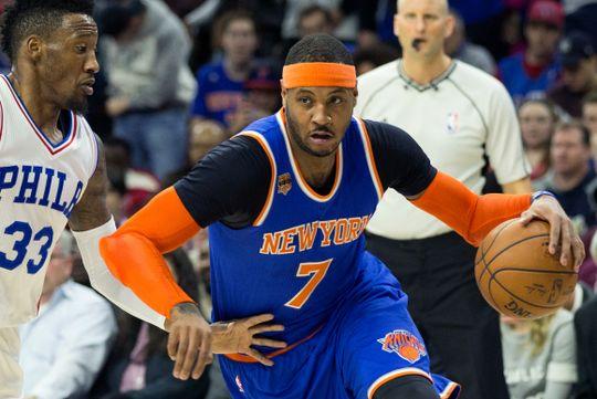 New York Knicks forward Carmelo Anthony (7) drives past Philadelphia Sixers forward Robert Covington (33).  Bill Streicher-USA TODAY Sports.