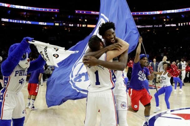 Philadelphia Sixers Joel Embiid and T.J. McConnell celebrate their victory. Photo courtesy of Matt Slocum/Associated Press.