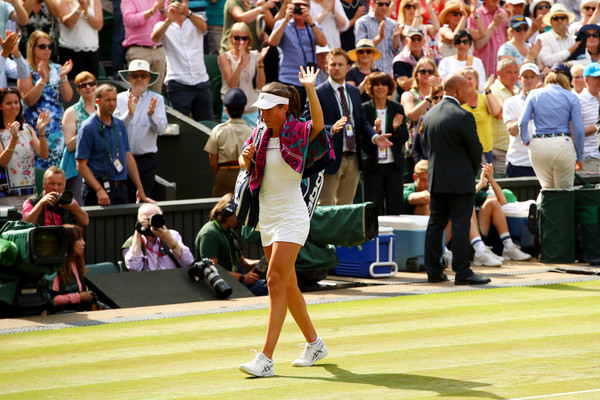 A dejected Konta acknowledged the crowd when she was walking off Centre Court (Photo by Clive Brunskill / Getty)